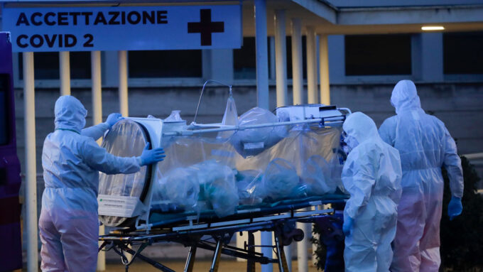 medical staff transporting a patient at a hospital in Rome