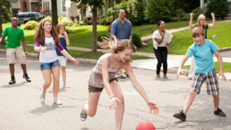 black and white people playing in the street