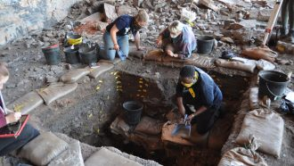 scientists excavating a rock shelter in the Kalahari Desert