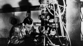 black and white photo of Ernst Ruska at an electron microscope