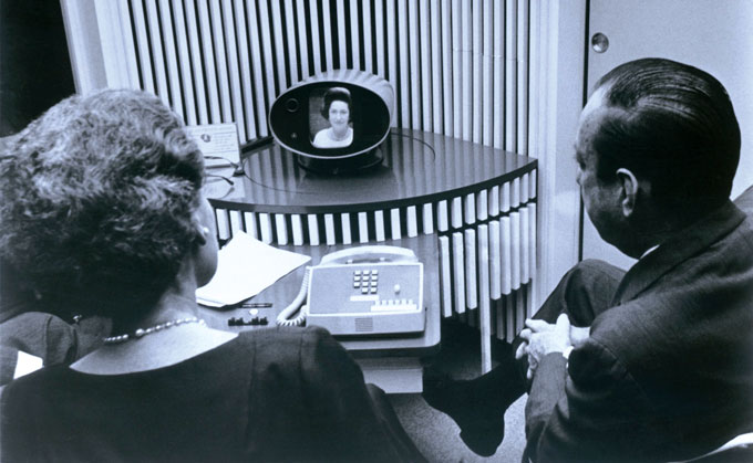 man and woman watching Lady Bird Johnson on a prototype AT&T videophone