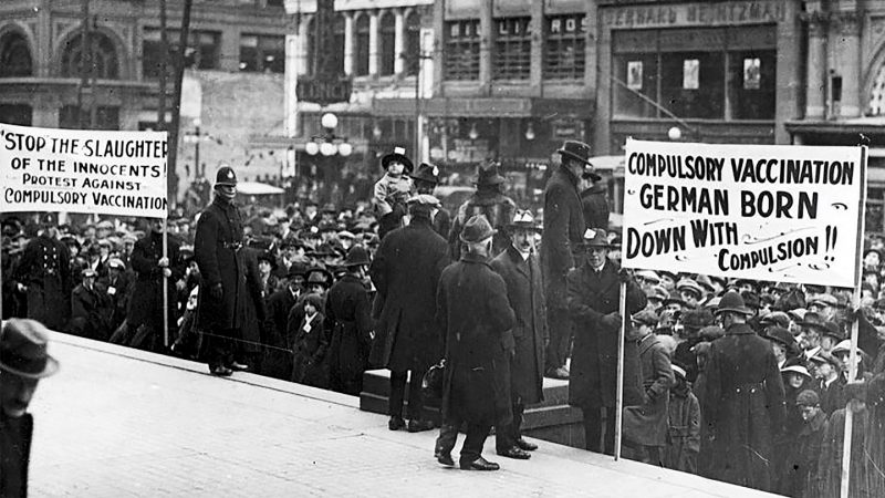 a black and white photo showing an anti-vaccination demonstration