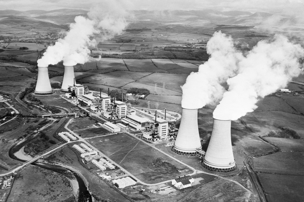 aerial black and white photo of a nuclear power plant