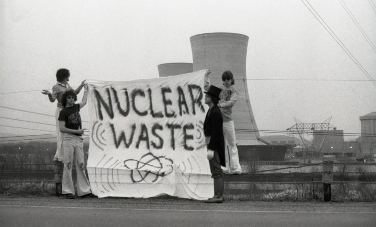 protesters standing in front of Three Mile Island reactor