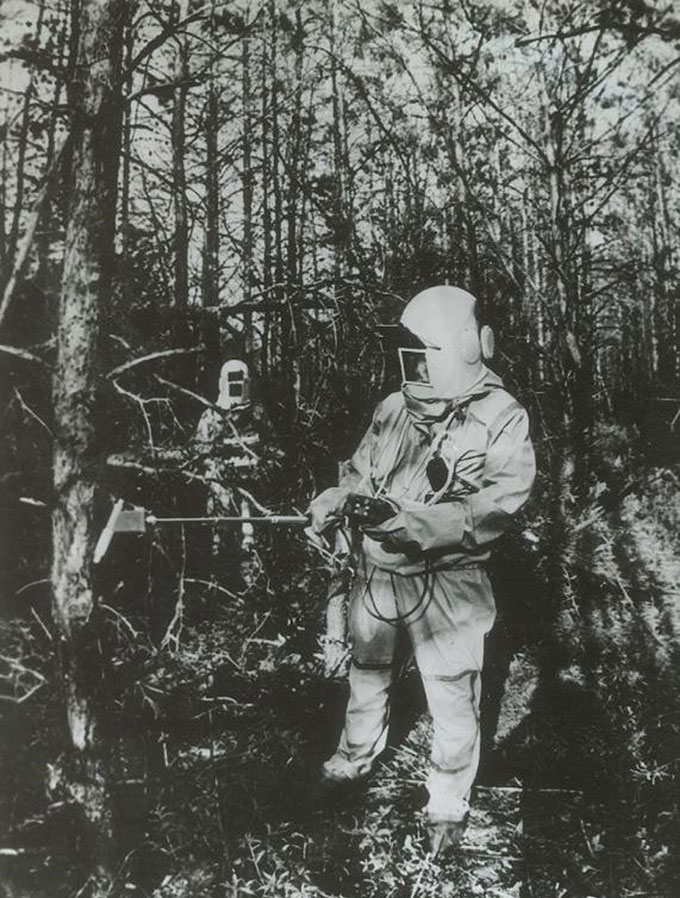 workers measuring radiation in a Chernobyl forest