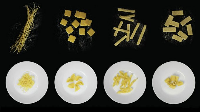 four different types of pasta curled in bowls and uncurled on a black surface
