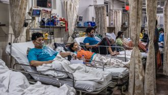 covid patients in beds at a New Delhi hospital