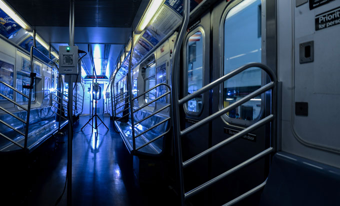 New York subway train car with blue UV lights