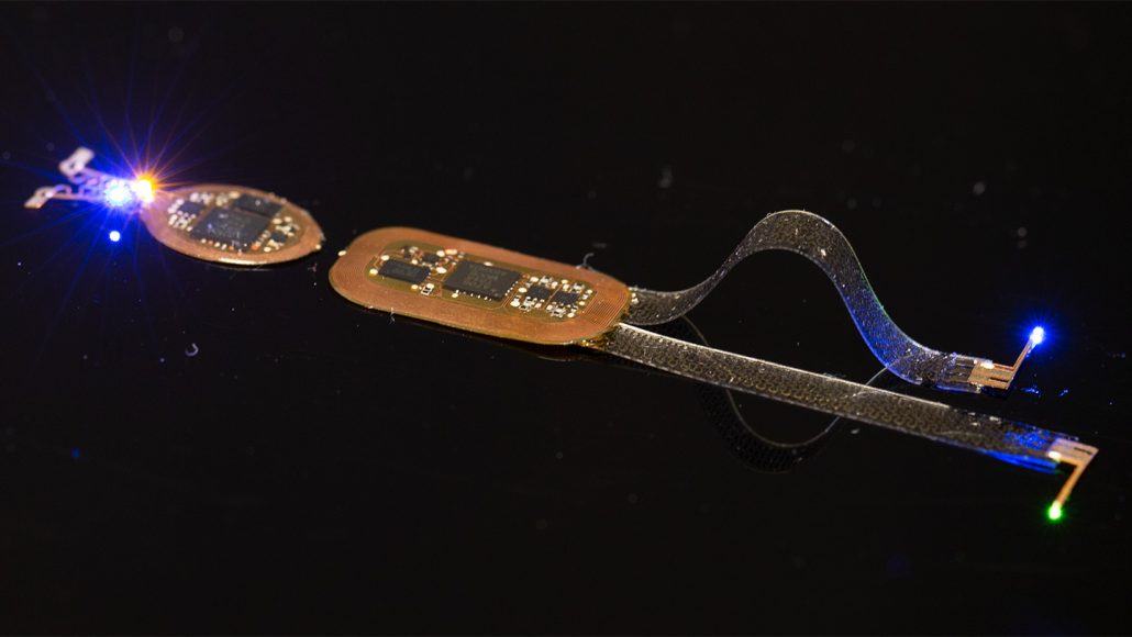 a long, thin electronic device with microchips in the middle and lights at either end