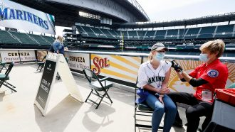 woman receiving a covid-19 vaccine dose at Seattle Mariners's stadium