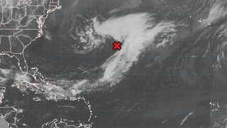 radar image of Subtropical Storm Ana marked with a red x