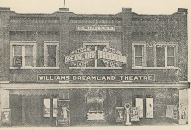grainy black and white image of the exterior of the Dreamaland theater before the massacre
