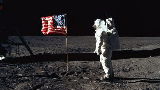 a photo of an astronaut at the Apollo 11 moon landing site