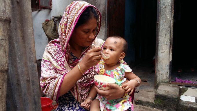 mother in Bangladesh feeding malnourished child