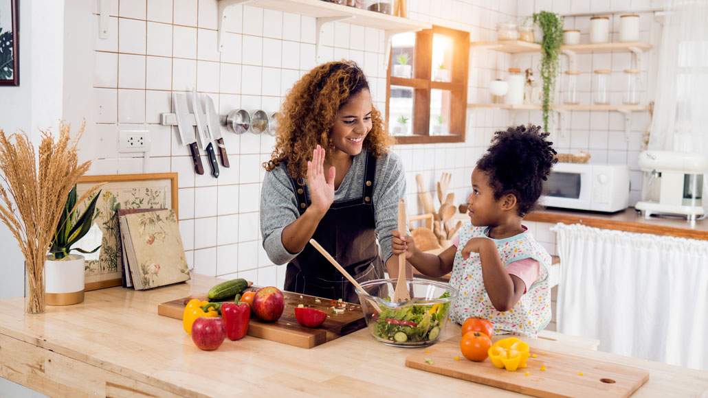 stock image of a mother and daughter in the kitchen