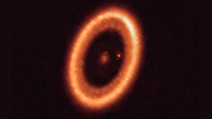 star PDS 70 surrounded by dusty ring of debris, with bright dot inside ring that may be a moon forming