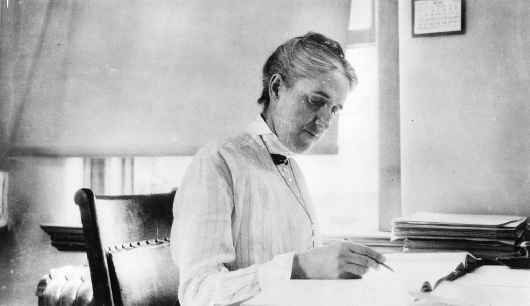 black and white image of Henrietta Leavitt sitting at a desk