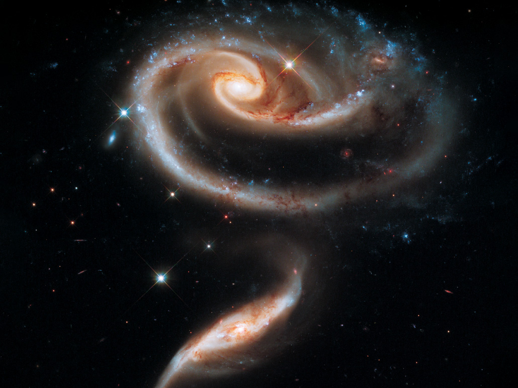 two spiral galaxies that appear connected