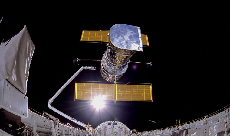 photo of the Hubble space telescope being released in space