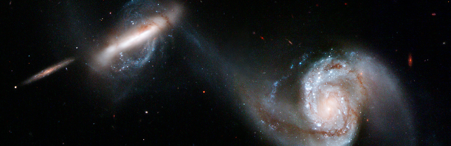 two galaxies on a black background