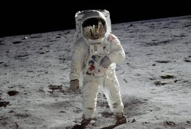 Buzz Aldrin in a space suit standing on the moon