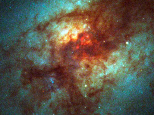 a messy galaxy shown in red and blue
