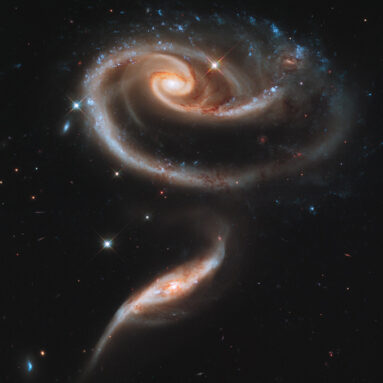 a pair of spiral galaxies, one above the other