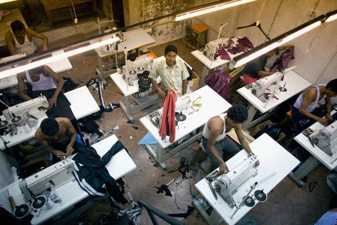 tailors working at desks in Mumbai