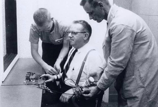 a man being hooked up to a shock machine