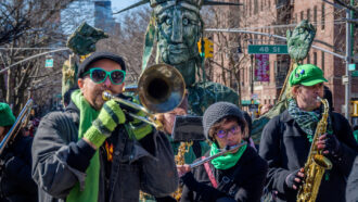 a trombone player, a flute player and a saxophone player in a parade