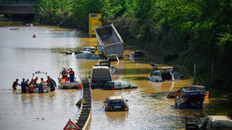 cars stranded on a flooded out highway