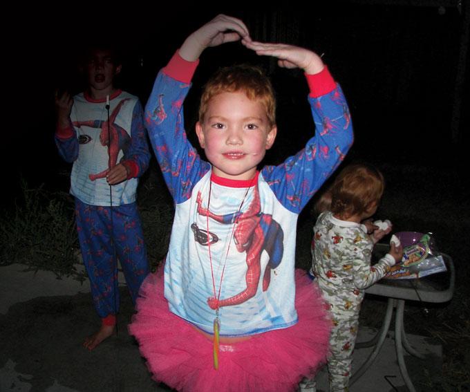 image of Kyla Lechelt wearing a tutu and a spiderman shirt