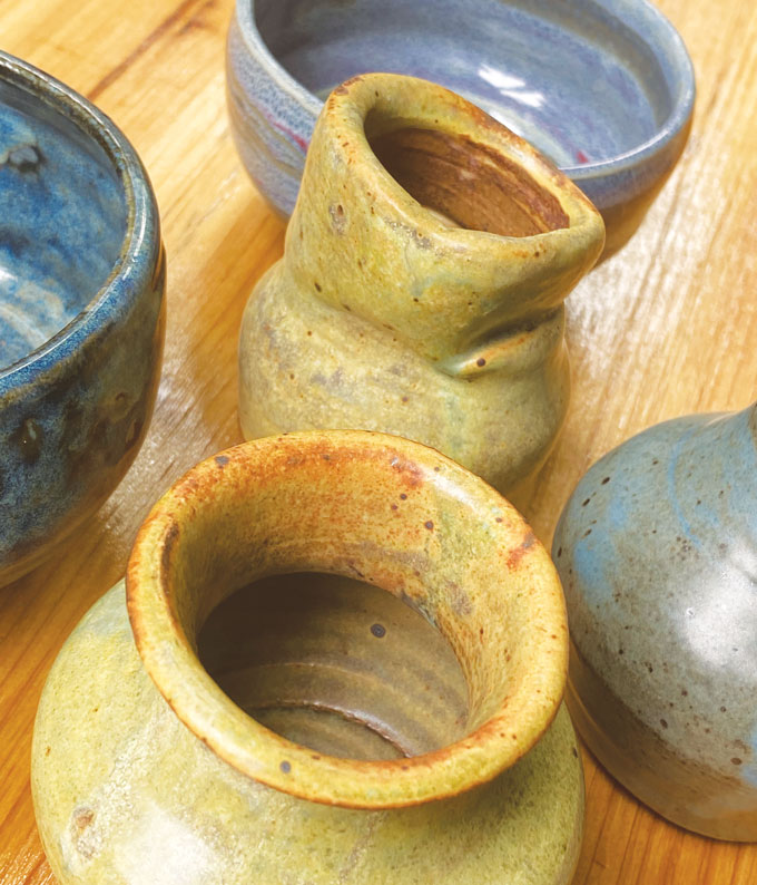 image of yellow and blue vases, bowls and cups