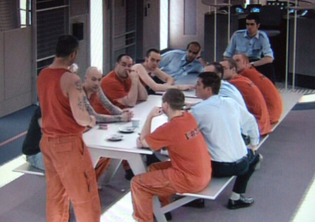 Prisoners at a table