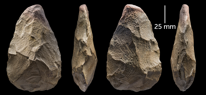 a stone hand axe shown from four different angles