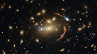 a black background highlights several galaxies, with a half-circle orange arc