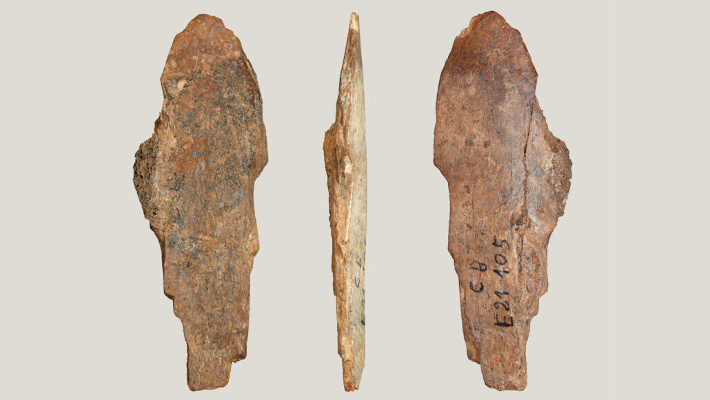 an ancient hide scraping tool shown at three different angles