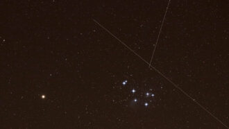 image of Mars and the Pleiades star cluster with crisscrossing streaks from Starlinks satellites