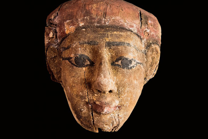 portion of Egyptian coffin depicting a human face