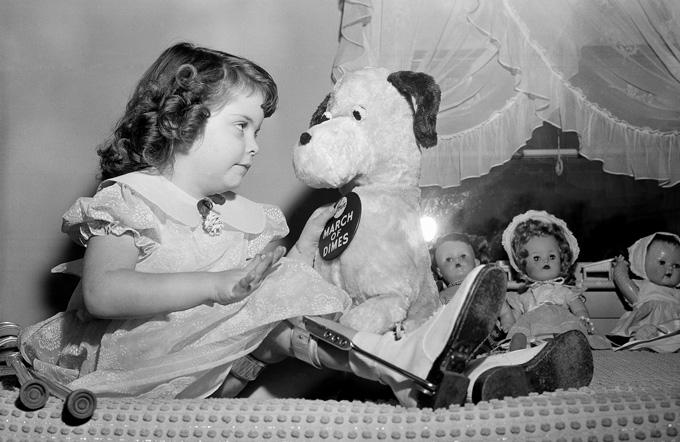 black and white image of Marlene Olsen with her toys