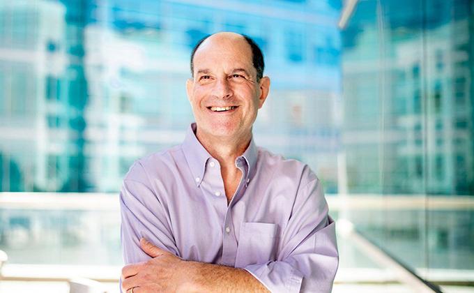 Nobel laureate David Julius standing in front of a glass backdrop