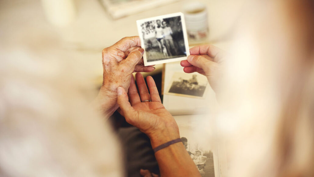 Women looking at an old photograph