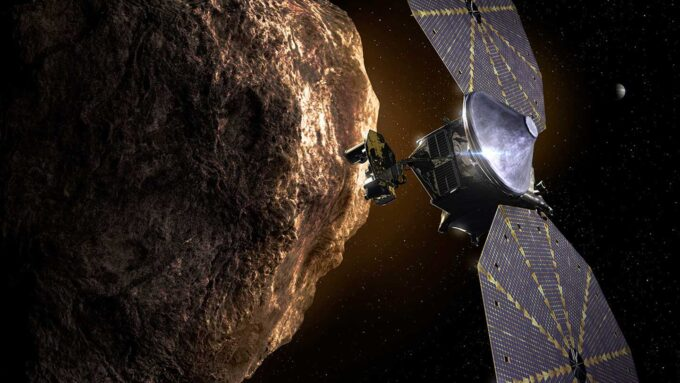 illustration of the Lucy spacecraft approaching an asteroid