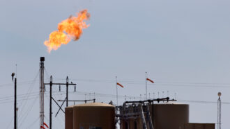 image of a flaming gas flare at an oil field in Texas