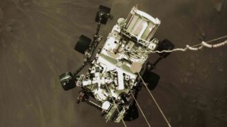image of Perseverance rover from above, landing on Mars